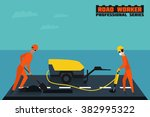 Two Road Workers Repairing The...