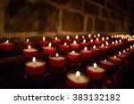 Votive Candles In A Church In...