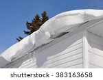 Thick Snow Hanging On The Roof