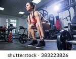young woman with a barbell in... | Shutterstock . vector #383223826