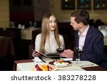 cheerful couple with menu in a... | Shutterstock . vector #383278228