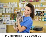 Stock photo portrait of a beautiful veterinarian holding young cat at clinic 383303596