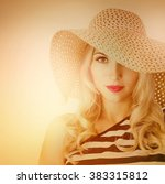 girl in a hat with a wide brim | Shutterstock . vector #383315812