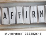 Small photo of AFFIRM word on wood blocks concept