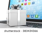gift box with ribbon on laptop... | Shutterstock . vector #383434366