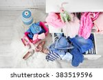 child clothes in wooden chest... | Shutterstock . vector #383519596
