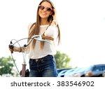 trendy hipster girl with bike...   Shutterstock . vector #383546902