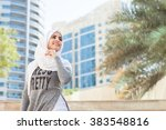 smiling girl in hijab covering... | Shutterstock . vector #383548816