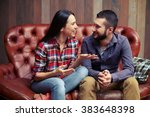 smiley couple sitting on couch... | Shutterstock . vector #383648398