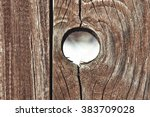A Hole In A Wooden Fence.