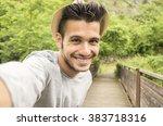 handsome guy is taking a selfie ... | Shutterstock . vector #383718316