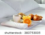 Breakfast in bed in hotel room. Accommodation. - stock photo