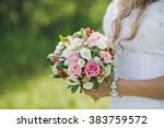 bouquet in the hands of the... | Shutterstock . vector #383759572