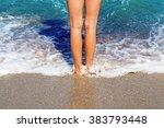 Small photo of Healthy beautiful tan female legs on the sandy sea beach