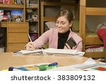 Stock photo female student studying in her dormitory 383809132