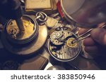 A Watch Maker Repairing A...