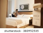 Stock photo asian hotel maid making bed view from the entrance of the room 383952535