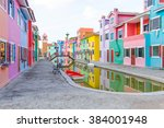 colorful townhouse and the pond | Shutterstock . vector #384001948