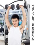people working out in modern gym | Shutterstock . vector #384027016