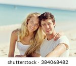romantic young couple sitting... | Shutterstock . vector #384068482