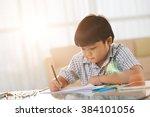 vietnamese little boy sitting... | Shutterstock . vector #384101056