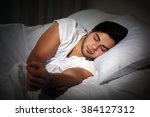 young man sleeping in bed at... | Shutterstock . vector #384127312