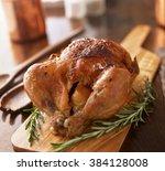 Rotisserie Chicken On Wooden...