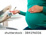 close up of a pregnant woman... | Shutterstock . vector #384196036