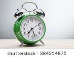 classic green alarm clock...   Shutterstock . vector #384254875