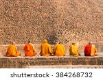 Buddhist Monks Sitting In Fron...
