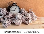 alarm clock in a wastepaper ... | Shutterstock . vector #384301372