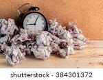 alarm clock in a wastepaper ... | Shutterstock . vector #384301372
