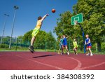 boy performs foul shot at... | Shutterstock . vector #384308392