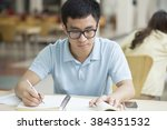 asian male student studying in... | Shutterstock . vector #384351532