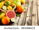 citrus fruits on a brown wooden ... | Shutterstock . vector #384388615