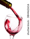 closeup of red wine pouring... | Shutterstock . vector #384462616