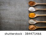 various spices on wooden spoons.... | Shutterstock . vector #384471466