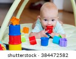 baby playing with colorful toys | Shutterstock . vector #384472582
