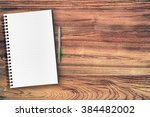 a blank notebook page and pen... | Shutterstock . vector #384482002