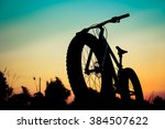 Silhouette Fat Bike At Sunset...