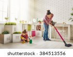 happy family cleans the room.... | Shutterstock . vector #384513556