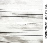 wooden grey polished background | Shutterstock . vector #384541456