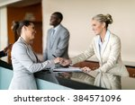 businessman check in at hotel... | Shutterstock . vector #384571096