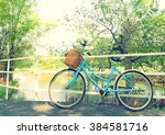 bicycle waiting near tree in... | Shutterstock . vector #384581716