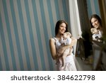 happy mother with newborn baby... | Shutterstock . vector #384622798