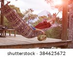 person relaxing lying in... | Shutterstock . vector #384625672