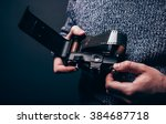 photographer loading roll film... | Shutterstock . vector #384687718