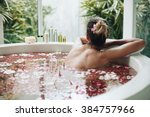 woman relaxing in round outdoor ...   Shutterstock . vector #384757966