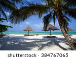 Zanzibar Umbrellas And Palm...