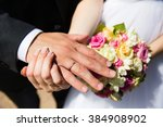 hands with wedding rings on... | Shutterstock . vector #384908902